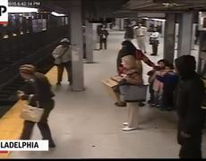 Video - Man Falls on Subway Tracks and Pulled to Safety