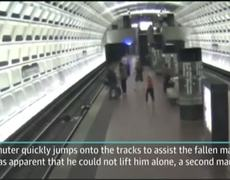 Subway VIDEO - Wheelchair Man Falls On Train Tracks, People Rush to Rescue