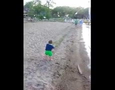 Boy catches fish with his hands