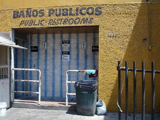 Public restrooms, without toilet paper.