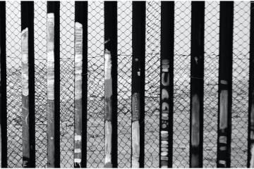Mujer cae 10 metros al intentar cruzar muro fronterizo
