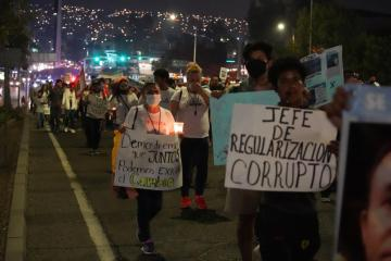 More than a thousand people marched in Tijuana to demand security...