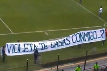 A fan asks his girlfriend to marry him during a soccer match