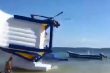 Mexican Police Helicopter flips over a kids jumper in Cancun