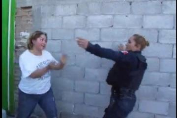 Mexican Police Officer kicks woman