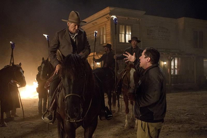 Harrison Ford and Jon Favreau in Cowboys & Aliens (2011)  Titles: Cowboys & Aliens
